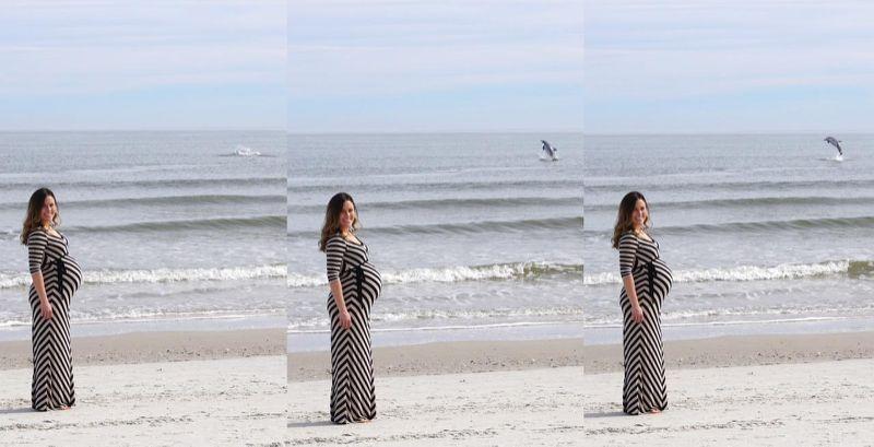 Il delfino che salta dietro il pancione della donna incinta